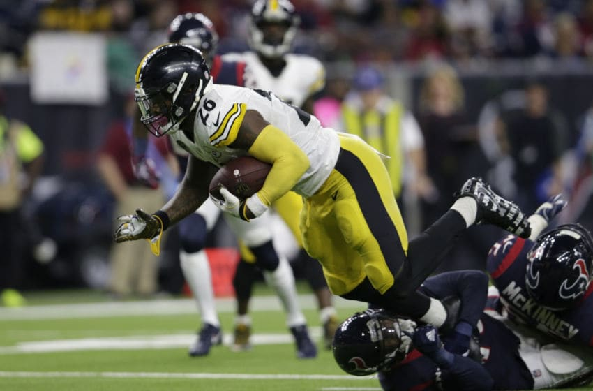 HOUSTON, TX - DECEMBER 25: Le'Veon Bell #26 of the Pittsburgh Steelers rushes for a touchdown in the third quarter defended by Corey Moore #43 of the Houston Texans and Benardrick McKinney #55 at NRG Stadium on December 25, 2017 in Houston, Texas. (Photo by Tim Warner/Getty Images)