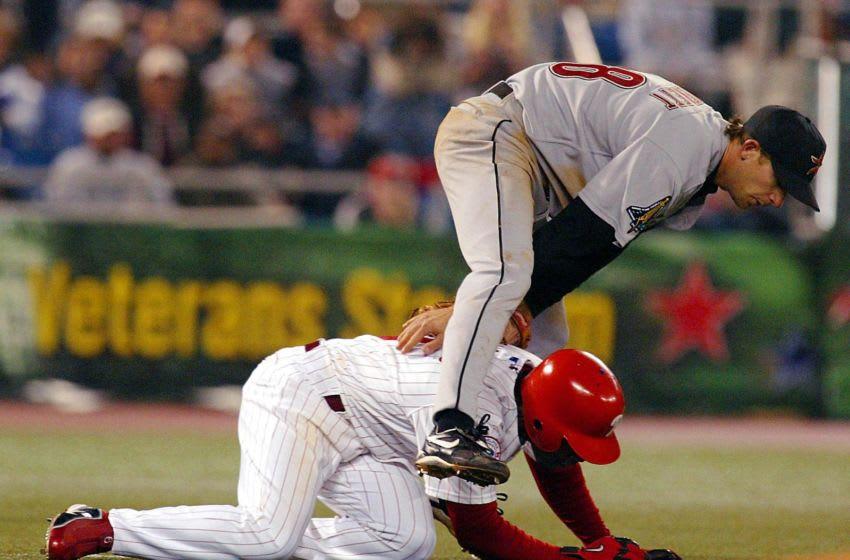 Houston Astros third baseman Adam Everett (top) leaps over Philadelphia Phillies Jimmy Rollins (Photo by TOM MIHALEK/AFP via Getty Images)