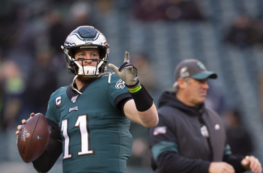 PHILADELPHIA, PA - JANUARY 05: Carson Wentz #11 of the Philadelphia Eagles warms up as head coach Doug Pederson looks on prior to the NFC Wild Card game against the Seattle Seahawks at Lincoln Financial Field on January 5, 2020 in Philadelphia, Pennsylvania. (Photo by Mitchell Leff/Getty Images)