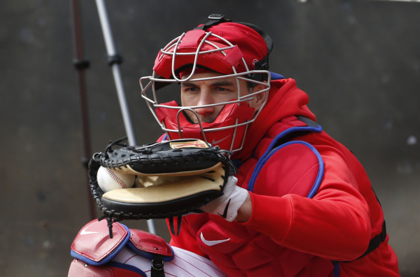 Feb 21, 2020; Clearwater, Florida, USA; Philadelphia Phillies catcher J.T. Realmuto (10) catches during workouts at Spectrum Field Mandatory Credit: Butch Dill-USA TODAY Sports