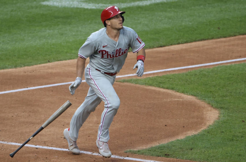 Aug 25, 2020; Washington, District of Columbia, USA; Philadelphia Phillies catcher J.T. Realmuto (10) hits a three run home run against the Washington Nationals in the third inning at Nationals Park. Mandatory Credit: Geoff Burke-USA TODAY Sports