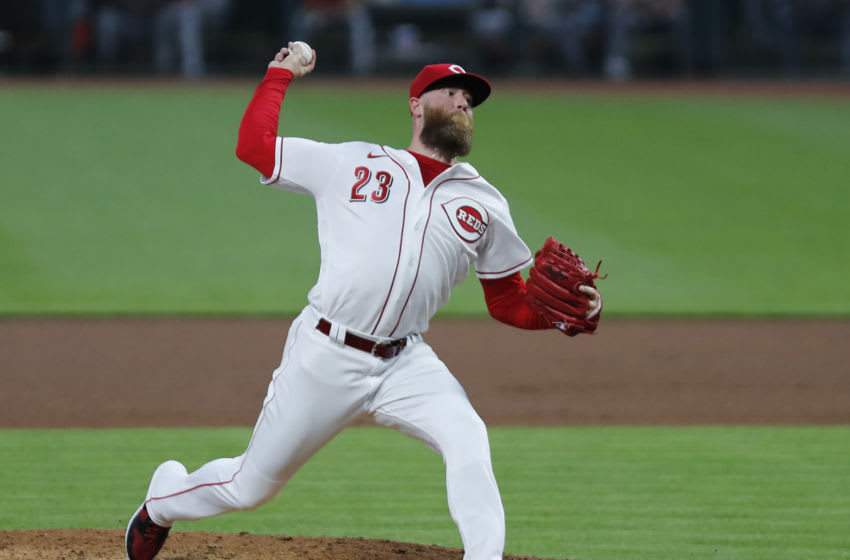 Sep 1, 2020; Cincinnati, Ohio, USA; Cincinnati Reds relief pitcher Archie Bradley (23) throws against the St. Louis Cardinals during the fourth inning at Great American Ball Park. Mandatory Credit: David Kohl-USA TODAY Sports
