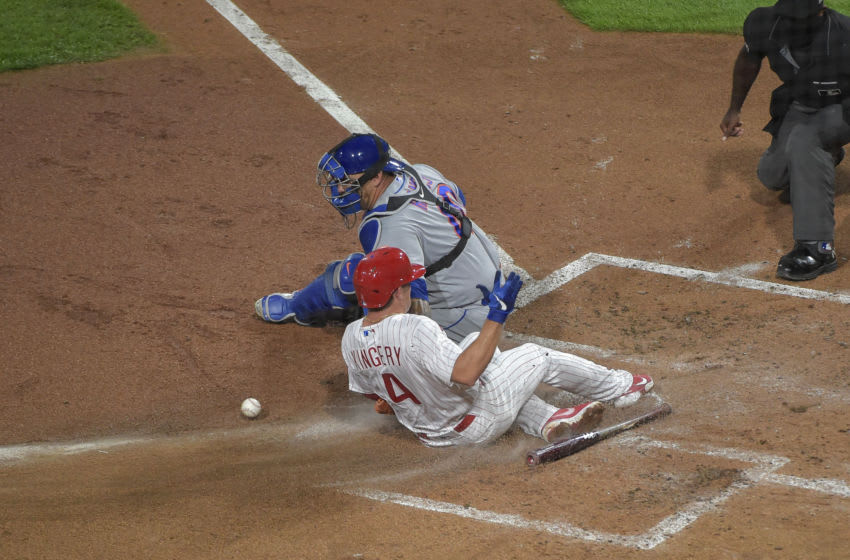 Sep 16, 2020; Philadelphia, Pennsylvania, USA; Philadelphia Phillies second baseman Scott Kingery (4) scores as New York Mets catcher Wilson Ramos (40) is unable to make the play at home plate during the second inning of the game at Citizens Bank Park. Mandatory Credit: John Geliebter-USA TODAY Sports