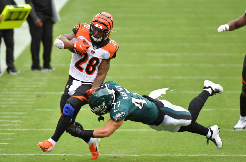 Sep 27, 2020; Philadelphia, Pennsylvania, USA; Cincinnati Bengals running back Joe Mixon (28) is knocked out of bounds by Philadelphia Eagles linebacker Nate Gerry (47) during the third quarter at Lincoln Financial Field. Mandatory Credit: Eric Hartline-USA TODAY Sports