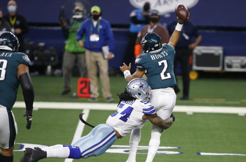 Dec 27, 2020; Arlington, Texas, USA; Dallas Cowboys middle linebacker Jaylon Smith (54) hits Philadelphia Eagles quarterback Jalen Hurts (2) as he throws a pass in the third quarter at AT&T Stadium. Mandatory Credit: Tim Heitman-USA TODAY Sports