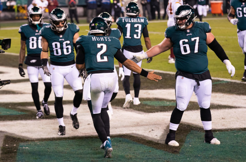 Jan 3, 2021; Philadelphia, Pennsylvania, USA; Philadelphia Eagles quarterback Jalen Hurts (2) celebrates with teammates after a touchdown run against the Washington Football Team during the second quarter at Lincoln Financial Field. Mandatory Credit: Bill Streicher-USA TODAY Sports