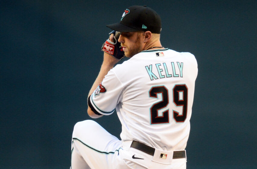 Apr 27, 2021; Phoenix, Arizona, USA; Arizona Diamondbacks starting pitcher Merrill Kelly (29) pitches against the San Diego Padres during the first inning at Chase Field. Mandatory Credit: Joe Camporeale-USA TODAY Sports