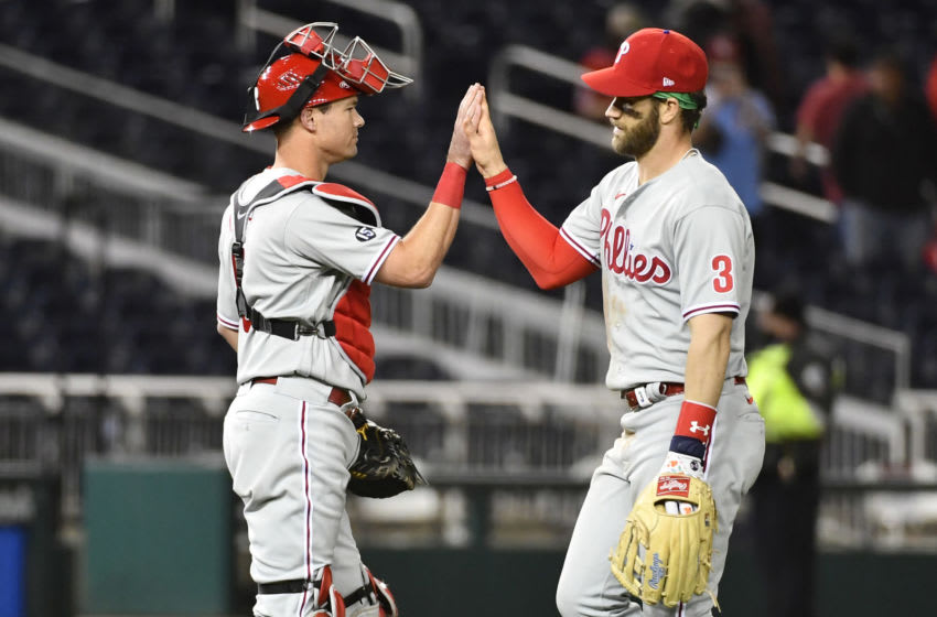 May 11, 2021; Washington, District of Columbia, USA; Philadelphia Phillies right fielder Bryce Harper (3) celebrates with Philadelphia Phillies catcher J.T. Realmuto (L) after defeating the Washington Nationals at Nationals Park. Mandatory Credit: Brad Mills-USA TODAY Sports