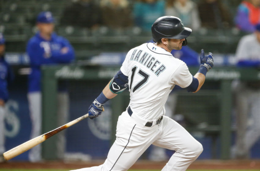 May 27, 2021; Seattle, Washington, USA; Seattle Mariners right fielder Mitch Haniger (17) this a single against the Texas Rangers during the seventh inning at T-Mobile Park. Mandatory Credit: Joe Nicholson-USA TODAY Sports