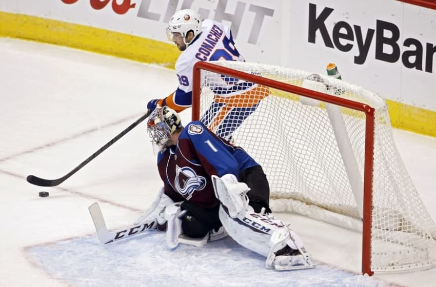 Oct 30, 2014; Denver, CO, USA; New York Islanders left wing Cory Conacher (89) looks to shoot the puck against Colorado Avalanche goalie Semyon Varlamov (1) during the first period at Pepsi Center. Mandatory Credit: Chris Humphreys-USA TODAY Sports