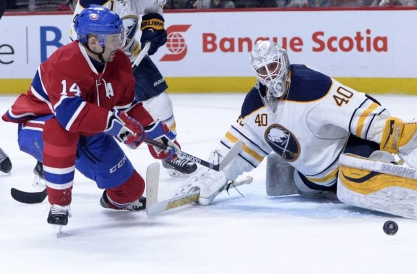 Mar 10, 2016; Montreal, Quebec, CAN; Buffalo Sabres goalie Robin Lehner (40) makes a save against Montreal Canadiens forward Tomas Plekanec (14) during the third period at the Bell Centre. Mandatory Credit: Eric Bolte-USA TODAY Sports