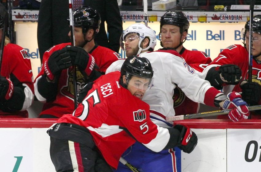 Mar 19, 2016; Ottawa, Ontario, CAN; Montreal Canadiens center Alex Galchenyuk (27) is checked into the boards by Ottawa Senators defenseman Cody Ceci (5) during the first period at Canadian Tire Centre. Mandatory Credit: Jean-Yves Ahern-USA TODAY Sports