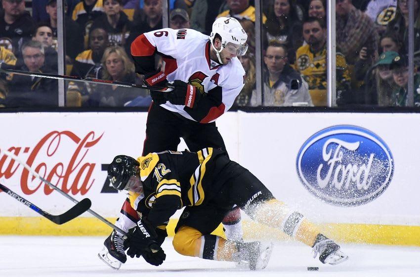 Apr 9, 2016; Boston, MA, USA; Boston Bruins center Frank Vatrano (72) falls to the ice in front of Ottawa Senators right wing Bobby Ryan (6) during the second period at TD Garden. Mandatory Credit: Bob DeChiara-USA TODAY Sports