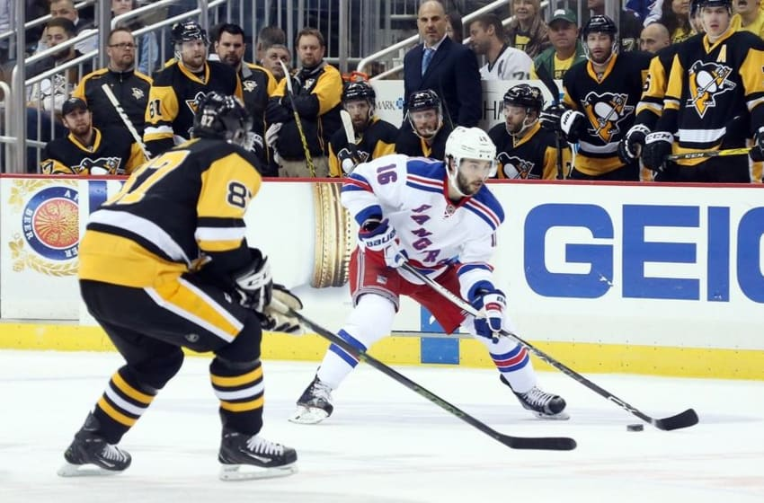 Apr 23, 2016; Pittsburgh, PA, USA; New York Rangers center Derick Brassard (16) skates with the puck as Pittsburgh Penguins center Sidney Crosby (87 )defends during the second period in game five of the first round of the 2016 Stanley Cup Playoffs at the CONSOL Energy Center. Mandatory Credit: Charles LeClaire-USA TODAY Sports
