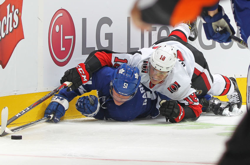 TORONTO, ON - OCTOBER 6: Ryan Dzingel #18 of the Ottawa Senators battles for the puck against Jake Gardiner #51 of the Toronto Maple Leafs during an NHL game at Scotiabank Arena on October 6, 2018 in Toronto, Ontario, Canada. The Senators defeated the Maple Leafs 5-3.(Photo by Claus Andersen/Getty Images)