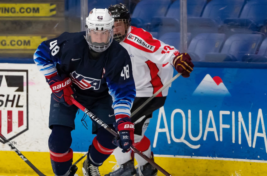 PLYMOUTH, MI - DECEMBER 12: Jake Sanderson #48 of the U.S. Nationals controls the puck against the Switzerland Nationals during day-2 of game two of the 2018 Under-17 Four Nations Tournament at USA Hockey Arena on December 12, 2018 in Plymouth, Michigan. USA defeated Switzerland 3-1. (Photo by Dave Reginek/Getty Images)