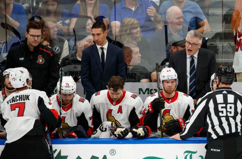 TAMPA, FL - MARCH 2: Ottawa Senators new Assistant Coach Chris Kelly and Head Coach Marc Crawford during the game against the Tampa Bay Lightning at Amalie Arena on March 2, 2019 in Tampa, Florida. (Photo by Casey Brooke Lawson/NHLI via Getty Images)