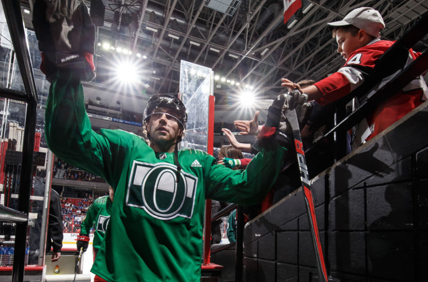 OTTAWA, ON - MARCH 16: Wearing a green St. Patrick's Day jersey, Bobby Ryan #9 of the Ottawa Senators high-fives fans as he leaves the ice after warmup prior to a game against the Toronto Maple Leafs at Canadian Tire Centre on March 16, 2019 in Ottawa, Ontario, Canada. (Photo by Andre Ringuette/NHLI via Getty Images)