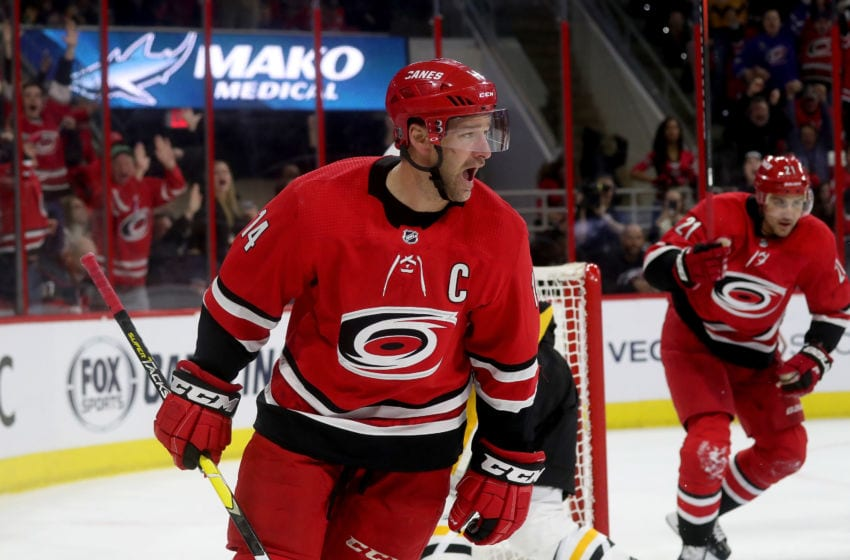 RALEIGH, NC - MARCH 19: Justin Williams #14 of the Carolina Hurricanes scores the game tying goal in regulation during an NHL game against the Pittsburgh Penguins on March 19, 2019 at PNC Arena in Raleigh, North Carolina. (Photo by Gregg Forwerck/NHLI via Getty Images)