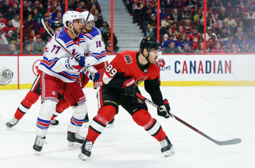 OTTAWA, ON - OCTOBER 5: Mikkel Boedker #89 of the Ottawa Senators looks for a pass as Tony DeAngelo #77 and Marc Staal #18 of the New York Rangers defend their end at Canadian Tire Centre on October 5, 2019 in Ottawa, Ontario, Canada. (Photo by Jana Chytilova/Freestyle Photography/Getty Images)