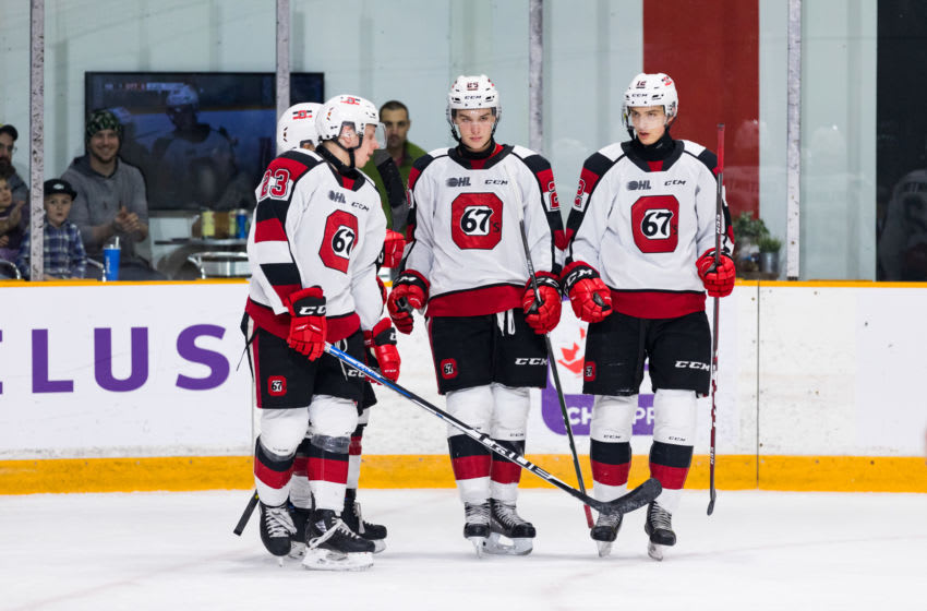 OTTAWA, ON - DECEMBER 01: Ottawa 67's Defenceman Alec Belanger (26) has a subdued goal celebration with Ottawa 67's Center Marco Rossi (23) and Ottawa 67's Defenceman Anthony Costantini (12) during Ontario Hockey League action between the North Bay Battalion and Ottawa 67's on December 1, 2019, at TD Place Arena in Ottawa, ON, Canada. (Photo by Richard A. Whittaker/Icon Sportswire via Getty Images)