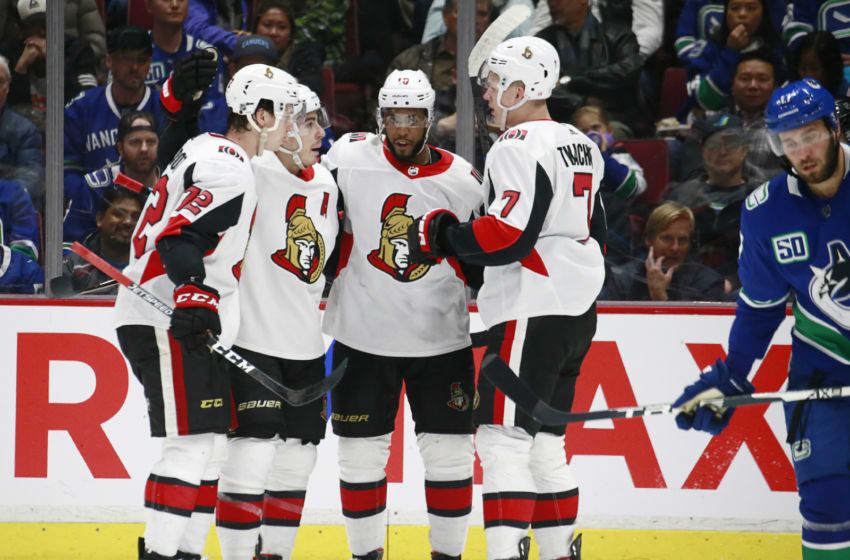 VANCOUVER, BC - DECEMBER 3: Jean-Gabriel Pageau #44 of the Ottawa Senators celebrates his goal against the Vancouver Canucks with teammates Thomas Chabot #72, Anthony Duclair #10, and Brady Tkachuk #7 during their NHL game at Rogers Arena December 3, 2019 in Vancouver, British Columbia, Canada. (Photo by Jeff Vinnick/NHLI via Getty Images)