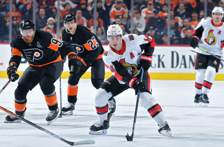 PHILADELPHIA, PA - DECEMBER 07: Jean-Gabriel Pageau #44 of the Ottawa Senators skates into the offensive zone ahead of Jakub Voracek #93 and Oskar Lindblom #23 of the Philadelphia Flyers in the first period at Wells Fargo Center on December 7, 2019 in Philadelphia, Pennsylvania. (Photo by Drew Hallowell/Getty Images)