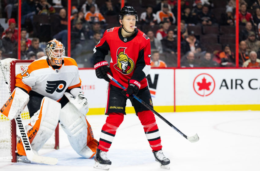 OTTAWA, ON - DECEMBER 21: Ottawa Senators Left Wing Brady Tkachuk (7) sets up in front of Philadelphia Flyers Goalie Brian Elliott (37) during second period National Hockey League action between the Philadelphia Flyers and Ottawa Senators on December 21, 2019, at Canadian Tire Centre in Ottawa, ON, Canada. (Photo by Richard A. Whittaker/Icon Sportswire via Getty Images)