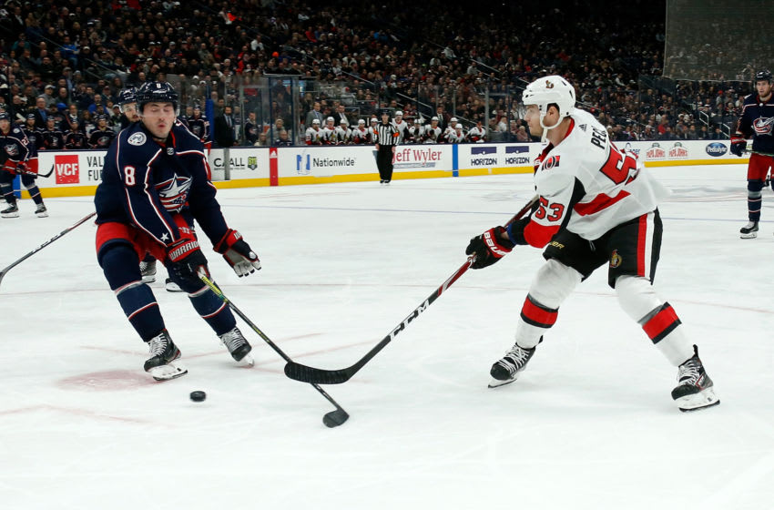 COLUMBUS, OH - FEBRUARY 24: Matthew Peca #53 of the Ottawa Senators shoots the puck past Zach Werenski #8 of the Columbus Blue Jackets during the game on February 24, 2020 at Nationwide Arena in Columbus, Ohio. Columbus defeated Ottawa 4-3 in overtime. (Photo by Kirk Irwin/Getty Images)