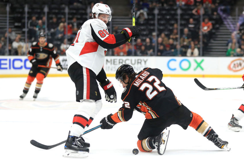 ANAHEIM, CALIFORNIA - MARCH 10: Ron Hainsey #81 of the Ottawa Senators battles Sonny Milano #22 of the Anaheim Ducks for a loose puck during the first period of a game at Honda Center on March 10, 2020 in Anaheim, California. (Photo by Sean M. Haffey/Getty Images)