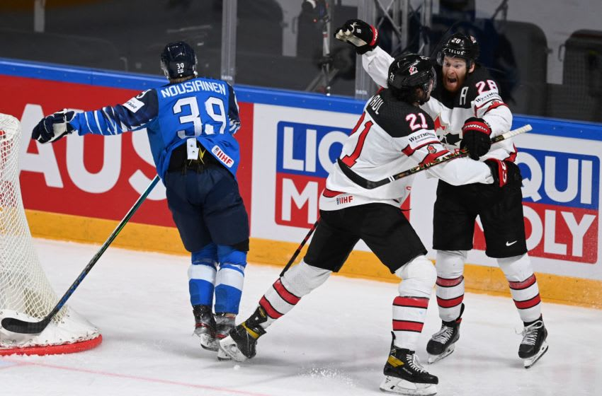 Canada's forward Nick Paul (C) celebrates scoring the winning 3-2 goal with team mate Canada's forward Connor Brown (R) during the IIHF Men's Ice Hockey World Championships final match between the Finland and Canada at the Arena Riga in Riga, Latvia, on June 5, 2021. - A 3-2 victory over Finland crowned Canada Ice Hockey World Champions 2021. (Photo by Gints IVUSKANS / AFP) (Photo by GINTS IVUSKANS/AFP via Getty Images)