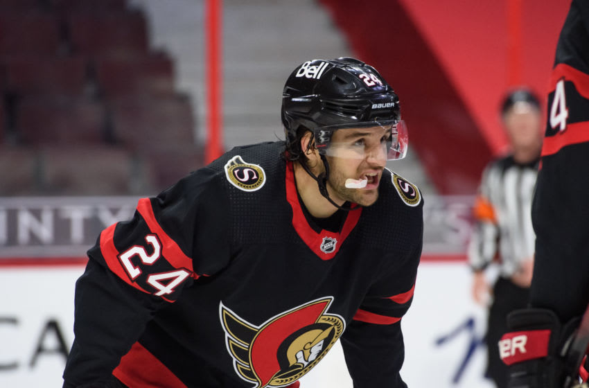 OTTAWA, ON - JANUARY 15: Christian Wolanin #24 of the Ottawa Senators looks on during a stoppage in play against the Toronto Maple Leafs at Canadian Tire Centre on January 15, 2021 in Ottawa, Ontario, Canada. (Photo by Matt Zambonin/Freestyle Photography/Getty Images)