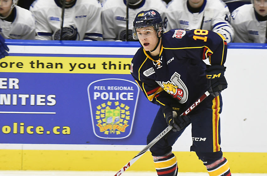 MISSISSAUGA, ON - DECEMBER 8: Zach Magwood #18 of the Barrie Colts controls the puck against the Mississauga Steelheads during OHL game action on December 8, 2017 at Hershey Centre in Mississauga, Ontario, Canada. (Photo by Graig Abel/Getty Images)