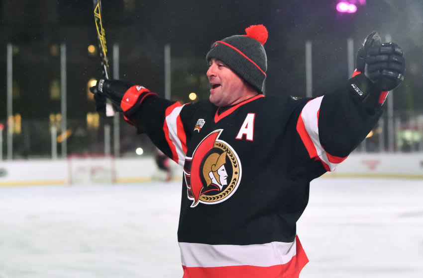 OTTAWA, ON - DECEMBER 15: Ottawa Senators alumni Chris Phillips #4 celebrates after a goal during the 2017 Scotiabank NHL100 Classic Ottawa Senators Alumni Game on Parliament Hill on December 15, 2017 in Ottawa, Canada. (Photo Minas Panagiotakis/NHLI via Getty Images)