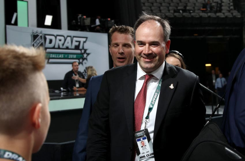 DALLAS, TX - JUNE 22: Genral Manager of the Ottawa Senators Pierre Dorion speaks with a runner prior to the first round of the 2018 NHL Draft at American Airlines Center on June 22, 2018 in Dallas, Texas. (Photo by Bruce Bennett/Getty Images)