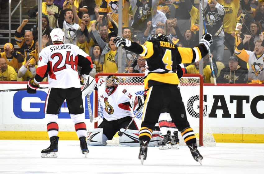 PITTSBURGH, PA - MAY 25: Justin Schultz #4 of the Pittsburgh Penguins celebrates after Chris Kunitz #14 scored the game winning goal against Craig Anderson #41 of the Ottawa Senators in the second overtime with a score of 3 to 2 in Game Seven of the Eastern Conference Final during the 2017 NHL Stanley Cup Playoffs at PPG PAINTS Arena on May 25, 2017 in Pittsburgh, Pennsylvania. (Photo by Jamie Sabau/Getty Images)
