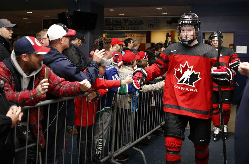 VICTORIA , BC - DECEMBER 19: Alexis Lafrenière #22 of Team Canada high fives with fans prior to a game versus Team Switzerland at the IIHF World Junior Championships at the Save-on-Foods Memorial Centre on December 19, 2018 in Victoria, British Columbia, Canada. Canada defeated Switzerland 5-3. (Photo by Kevin Light/Getty Images)
