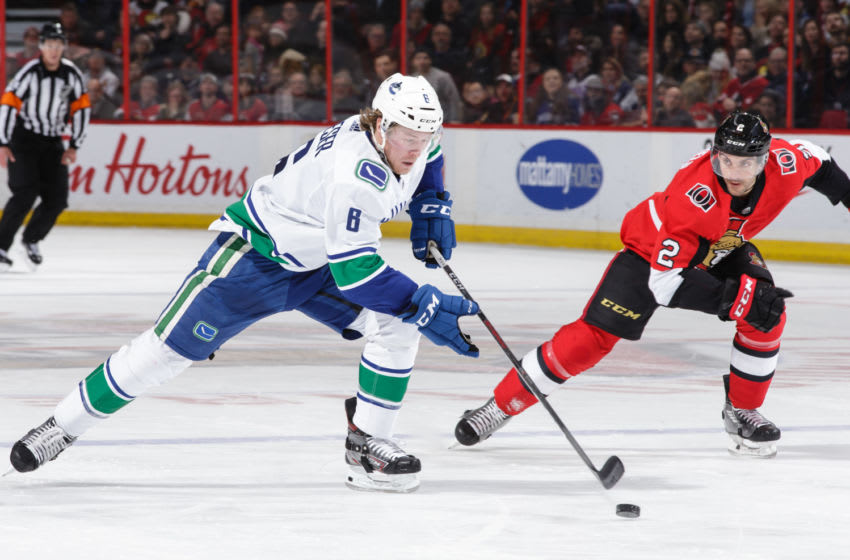 OTTAWA, ON - JANUARY 2: Brock Boeser #6 of the Vancouver Canucks shoots the puck against Dylan DeMelo #2 of the Ottawa Senators at Canadian Tire Centre on January 2, 2019 in Ottawa, Ontario, Canada. (Photo by Jana Chytilova/Freestyle Photography/Getty Images)