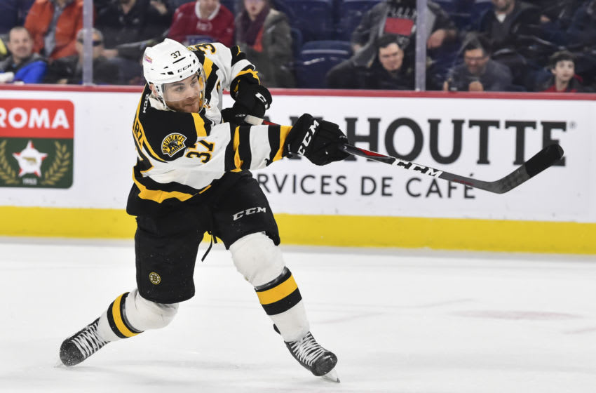 LAVAL, QC - MARCH 20: Jordan Szwarz #37 of the Providence Bruins shoots the puck in a shootout against the Laval Rocket during the AHL game at Place Bell on March 20, 2019 in Laval, Quebec, Canada. The Laval Rocket defeated the Providence Bruins 3-2 in a shootout. (Photo by Minas Panagiotakis/Getty Images)