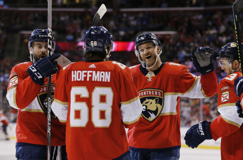 SUNRISE, FLORIDA - JANUARY 12: Jonathan Huberdeau #11 of the Florida Panthers celebrates with teammates after assisting a goal which made him the the all-time Florida Panthers leader in points during the third period against the Toronto Maple Leafs at BB&T Center on January 12, 2020 in Sunrise, Florida. (Photo by Michael Reaves/Getty Images)