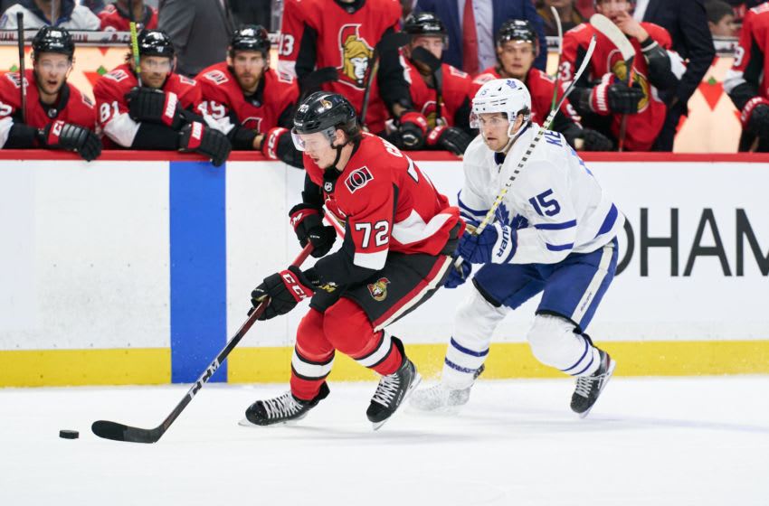 OTTAWA, ON - FEBRUARY 15: Thomas Chabot #72 of the Ottawa Senators skates with the puck against Alexander Kerfoot #15 of the Toronto Maple Leafs at Canadian Tire Centre on February 15, 2020 in Ottawa, Ontario, Canada. (Photo by Jana Chytilova/Freestyle Photography/Getty Images)