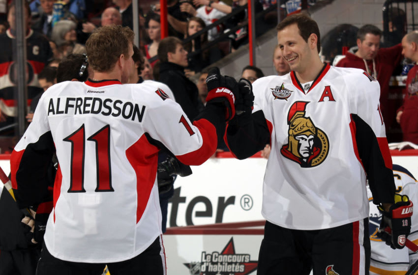 OTTAWA, ON - JANUARY 28: Daniel Alfredsson #11 of the Ottawa Senators and Jason Spezza #19 of the Ottawa Senators and Team Alfredsson react after a play against Team Chara during the 2012 Molson Canadian NHL All-Star Skills Competition at Scotiabank Place on January 28, 2012 in Ottawa, Ontario, Canada. (Photo by Bruce Bennett/Getty Images)