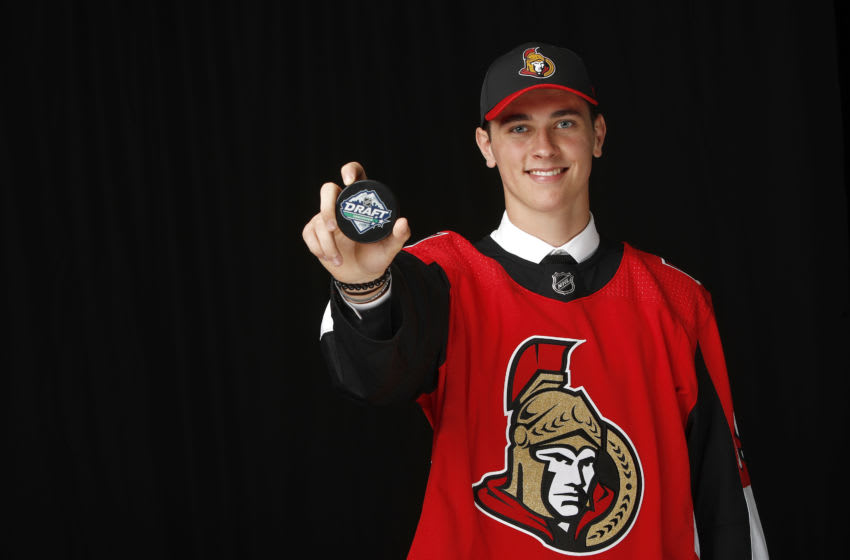 VANCOUVER, BRITISH COLUMBIA - JUNE 22: Shane Pinto poses after being selected 32nd overall by the Ottawa Senators during the 2019 NHL Draft at Rogers Arena on June 22, 2019 in Vancouver, Canada. (Photo by Kevin Light/Getty Images)