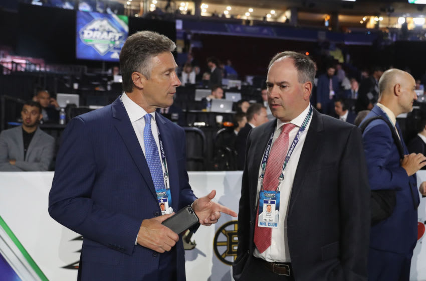 VANCOUVER, BRITISH COLUMBIA - JUNE 21: (L-R) Doug Wilson and Pierre Dorion attend the 2019 NHL Draft at the Rogers Arena on June 21, 2019 in Vancouver, Canada. (Photo by Bruce Bennett/Getty Images)