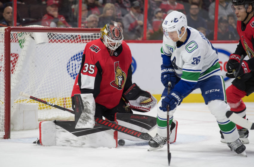 Feb 27, 2020; Ottawa, Ontario, CAN; Ottawa Senators goalie Marcus Hogberg (35) makes a save on a shot from Vancouver Canucks left wing Antoine Roussel (26) in the first period at the Canadian Tire Centre. Mandatory Credit: Marc DesRosiers-USA TODAY Sports