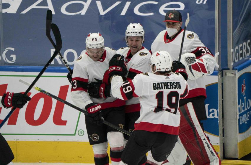 Feb 15, 2021; Toronto, Ontario, CAN; Ottawa Senators right wing Evgenii Dadonov (63) celebrates with center Josh Norris (9) after scoring a goal against the Toronto Maple Leafs during the overtime period at Scotiabank Arena. Mandatory Credit: Nick Turchiaro-USA TODAY Sports