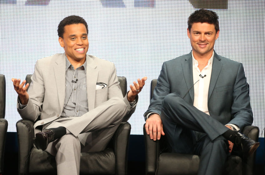 """BEVERLY HILLS, CA - AUGUST 01: Actors Michael Ealy (L) and Karl Urban speak onstage during the """"Almost Human"""" panel discussion at the FOX portion of the 2013 Summer Television Critics Association tour - Day 9 at The Beverly Hilton Hotel on August 1, 2013 in Beverly Hills, California. (Photo by Frederick M. Brown/Getty Images)"""