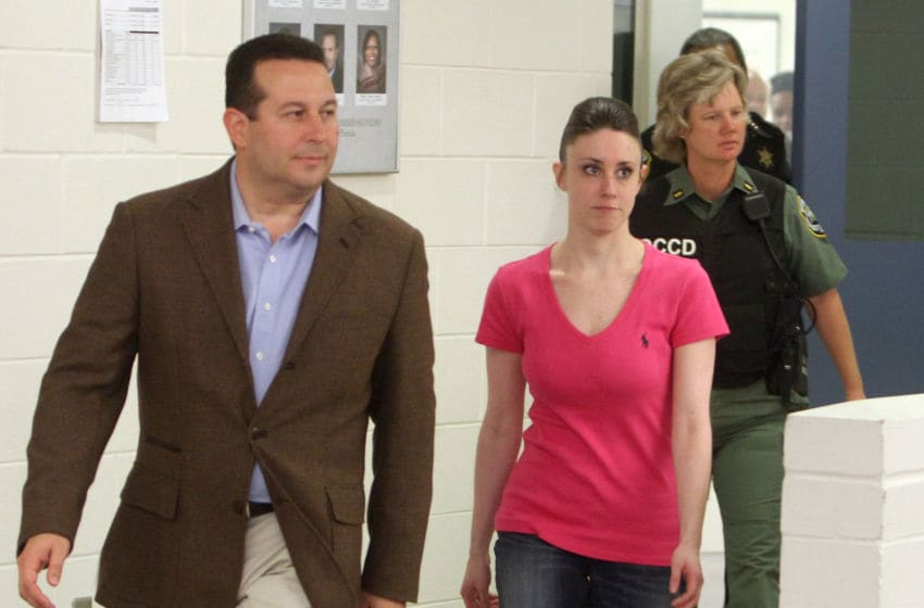 ORLANDO, FL - JULY 17: Casey Anthony leaves with her attorney Jose Baez from the Booking and Release Center at the Orange County Jail on July 17, 2011 in Orlando, Florida. After she was acquitted of murdering her daughter Caylee Anthony, it was unknown where Casey Anthony was going after the release. (Photo by Red Huber-Pool/Getty Images)