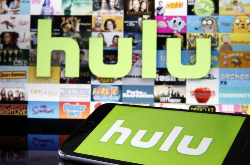 PARIS, FRANCE - MARCH 28: In this photo illustration, the Hulu media service provider's logo is displayed on the screen of an iPhone in front of the screen of a television showing the Hulu logo on March 28, 2020 in Paris, France. As the Coronavirus moves to the U.S., Disney has announced that it will provide a free 24/7 ABC news feed to Hulu Live to On-Demand subscribers. (Photo Illustration by Chesnot/Getty Images)