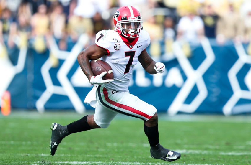 ATLANTA, GA - NOVEMBER 30: D'Andre Swift #7 of the Georgia Bulldogs rushes during the first half of the game against the Georgia Tech Yellow Jackets at Bobby Dodd Stadium on November 30, 2019 in Atlanta, Georgia. (Photo by Carmen Mandato/Getty Images)